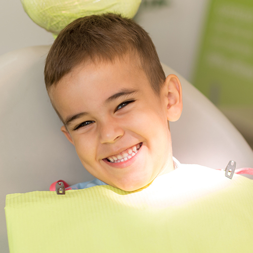 Child Smiling in a Chair